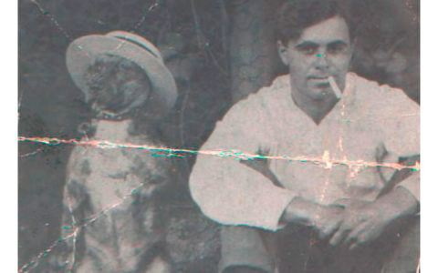 Damaged photo of man and his dog before photo restoration.