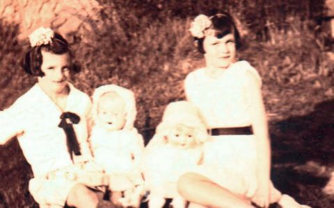 Repaired photo of girls and dolls after photo repair.